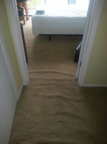 Before Carpet Cleaning and Repair (Stretching) in New Brunfels, TX
